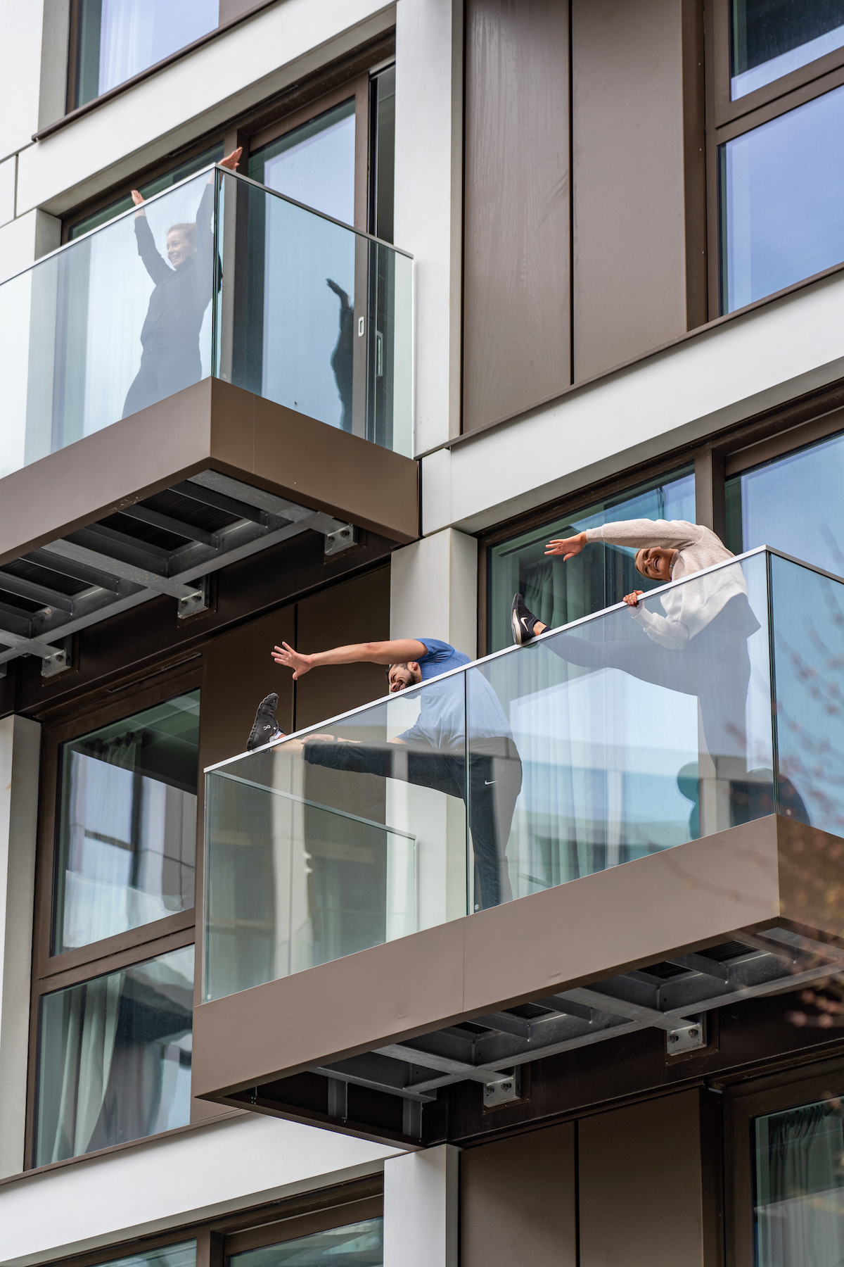 Residents workout from their balconies
